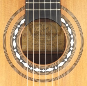 A Roudhloff x-braced Melophonic guitar of c. 1842 by Roudhloff, arguably the finest  achievement of  nineteenth-century guitar making in London.