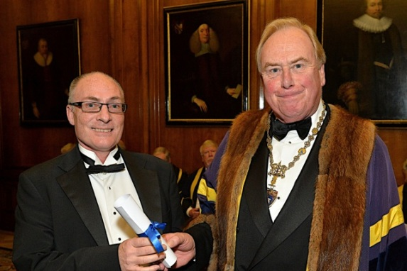 James receiving the award from the Master, Andrew Morris, at a Musicians' Company banquet, at Merchant Taylors' Hall, one of the great Livery Halls of the City of London  (photo: Peter Holland)